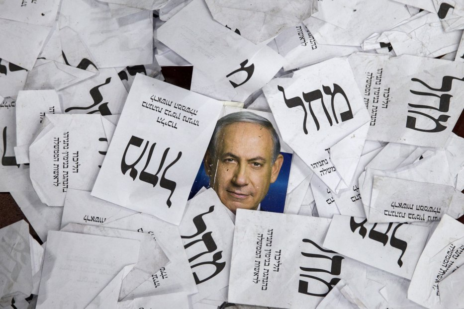Copies of ballots papers and campaign posters for Israel's Prime Minister Benjamin Netanyahu's Likud Party lie on the ground in the aftermath of the country's parliamentary elections, early on 18 March, 2015 in Tel Aviv [AFP PHOTO/JACK GUEZ/Getty