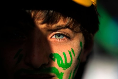 "A Muslim Yemeni boy with the world ""Allah"" in Arabic painted on his face attends a rally in the capital Sanaa on the occasion of the Prophet Mohammed's birthday on 30 November, 2017 [MOHAMMED HUWAIS/AFP/Getty Images]"
