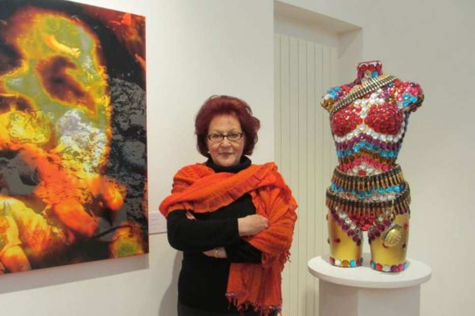 Palestinian artist Laila Shawa with her artwork