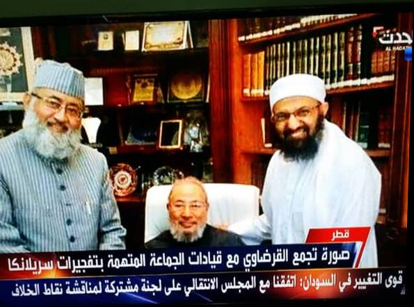 The image published by Al-Arabiya TV shows Sheikh Qaradawi with Dr. Salman Al Husaini Al Nadwi, the well known Indian scholar and professor in the Islamic sciences, and Dr. Adel Al-Harazi, a researcher in Sciences of Sunnah in 2016 [IUMS-Facebook]