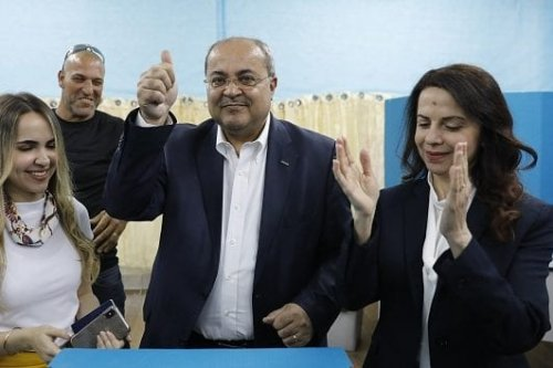 Israeli Arab politician Ahmed Tibi stands between his daughter (L) and wife as he casts his vote during Israel's parliamentary elections on 9 April 2019 in in the northern Israeli town of Taiyiba. [Ahmad GHARABLI / AFP / Getty]