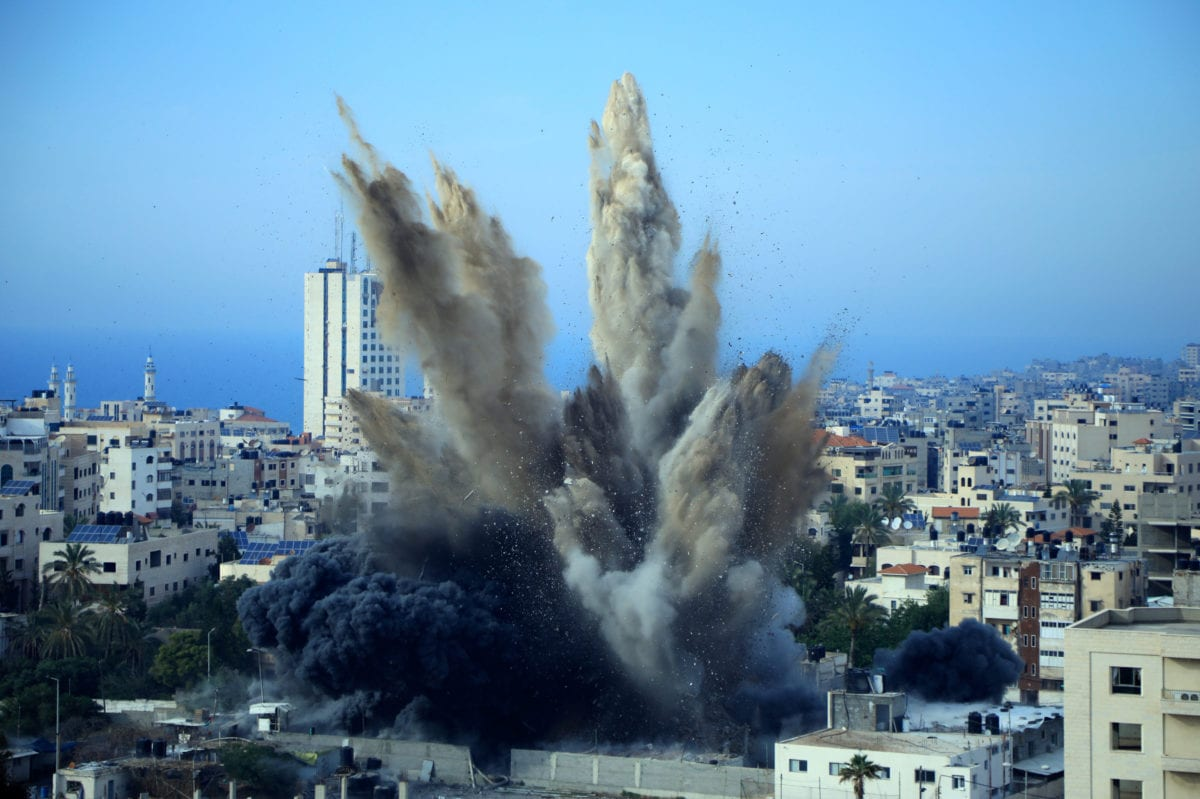 Smoke is seen rising following an Israeli airstrike on a building in Gaza city on May 5, 2019 [Ibrahim Khalaf/ApaImages]