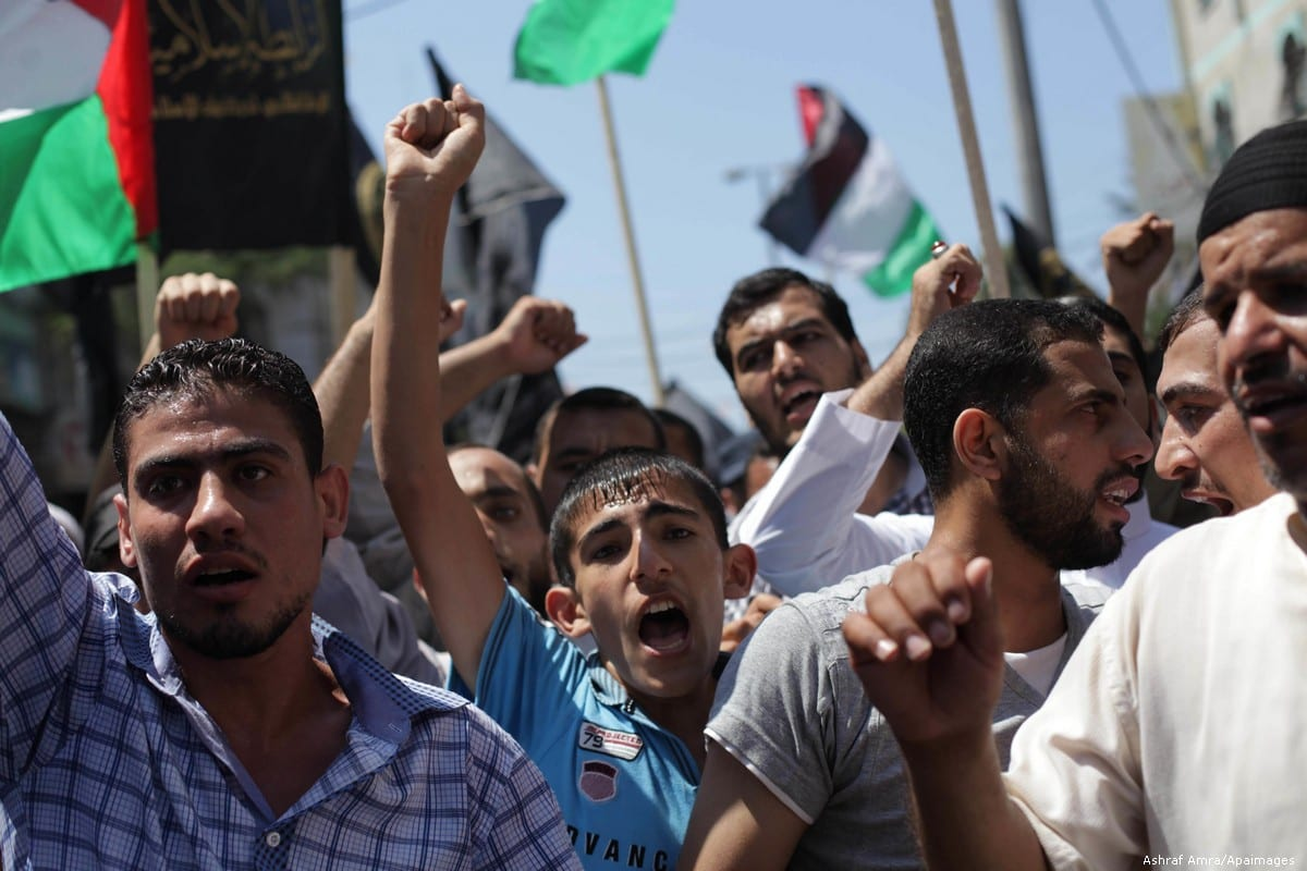 Palestinians take part in a protest marking the annual Quds Day in Gaza on 23 June 2013 [Ashraf Amra/Apaimages]