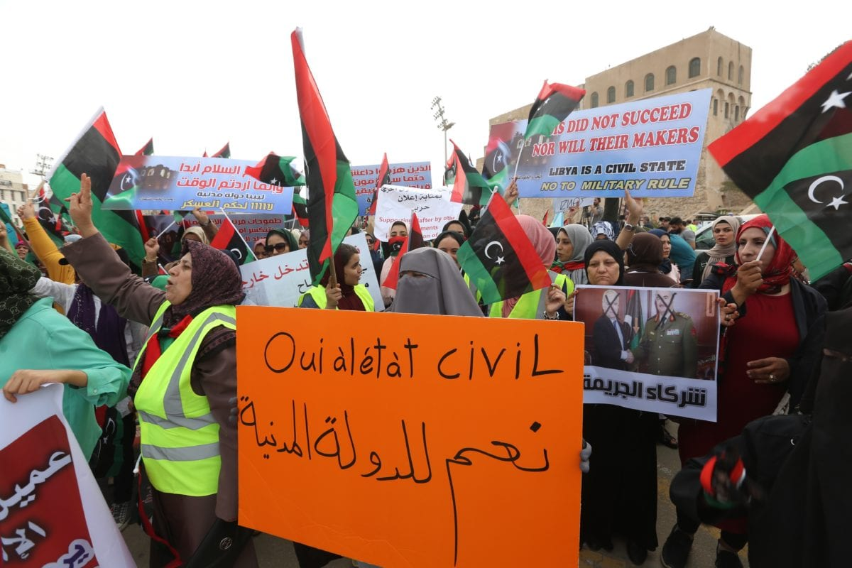 Libyans, some wearing yellow vests, hold banners during a protest against Khalifa Haftar, who commands forces loyal to Libya's eastern government and launches campaign to capture capital Tripoli, on 26 April 2019 in the Libyan capital Tripoli's Martyrs' Square. [Hazem Turkia - Anadolu Agency]