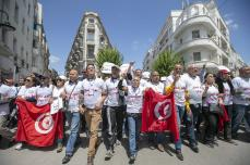 Tunisian academicians march to theatre building located in centre of the city from Education Ministry building, where they have staged sit-in protest for 42 days, to protest demanding increasing their salaries and reforms in universities in Tunis, Tunisia on 4 May, 2019 [Yassine Gaidi/Anadolu Agency]