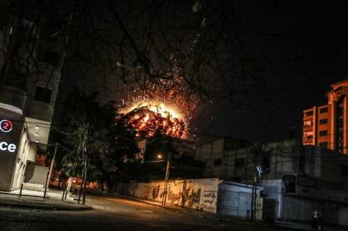Fire rises after Israeli warplanes hit the building where Anadolu Agency's office is located in Gaza on 4 May, 2019 [Ali Jadallah/Anadolu Agency]