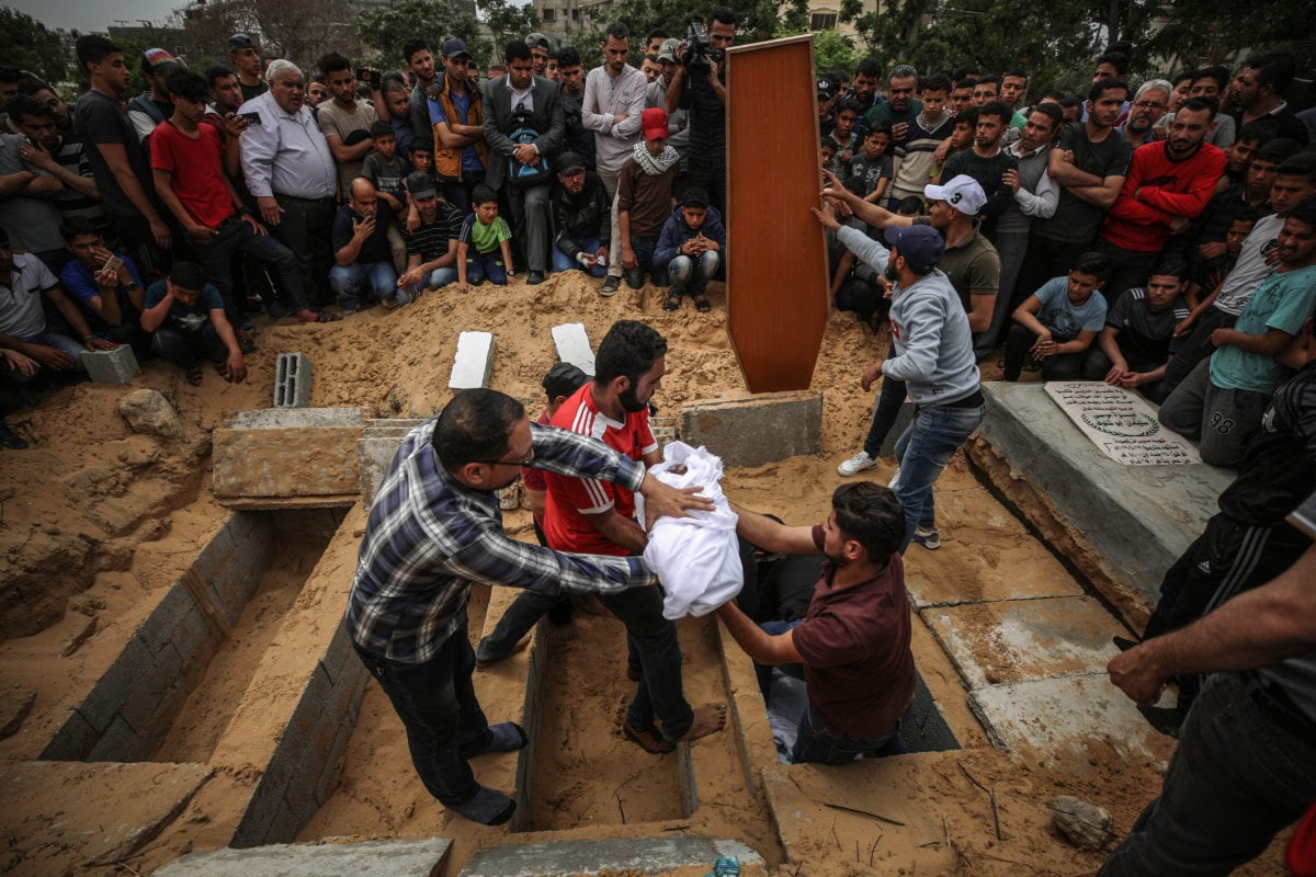 Palestinians are seen around are seen near the dead body of 4 month of Palestinian baby Maria who was killed by Israeli airstrikes on Gaza, during his funeral ceremony in Gaza City, Gaza on 6 May, 2019 [Ali Jadallah/Anadolu Agency]