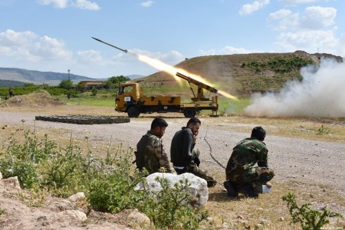 A missile vehicle of Free Syrian Army (FSA) launches a missile to hit the points of Assad regime and terror groups in Aleppo to retaliate against YPG/PKK attacks in Idlib de-escalation zone, on 9 May 2019, Aleppo, Syria. [Hişam el Homsi - Anadolu Agency]