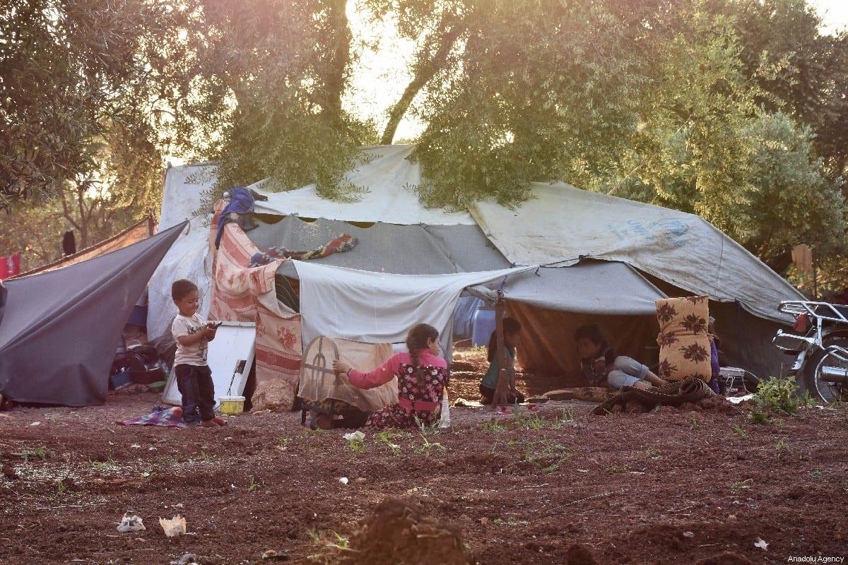 Syrian children are seen at a makeshift camp in Idlib, Syria on 14 May 2019 [Burak Karacaoğlu/Anadolu Agency]
