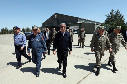 Turkish Defense Minister Hulusi Akar (C) inspects the 7th Main Jet Base Command in eastern Malatya where F-35 fighter jets will be deployed on 17 May 2019. [Arif Akdoğan - Anadolu Agency]