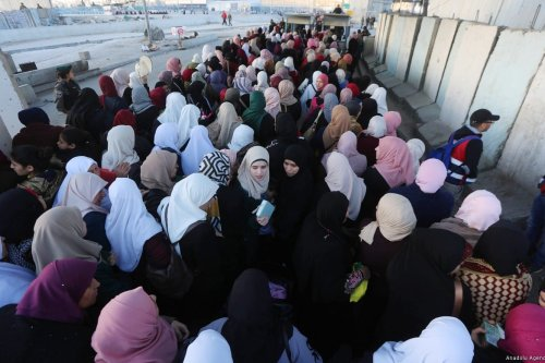 Palestinians cross Qalandiya checkpoint to perform the first Friday Prayer of Islamic holy month of Ramadan at the Al-Aqsa Mosque, in Ramallah, West Bank on 10 May, 2019 [Issam Rimawi/Anadolu Agency]