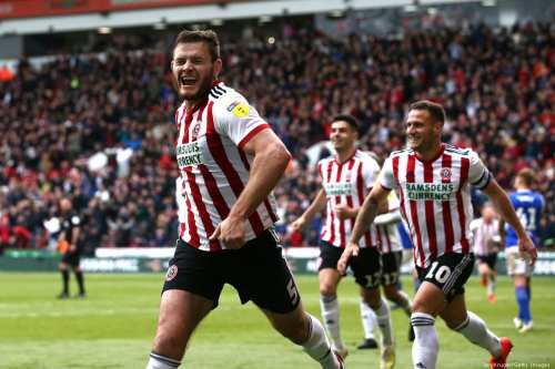 Players of the Sheffield United Football Club celebrates after scoring the second goal during a football match in in Sheffield, England on 27 April 2019 [Jan Kruger/Getty Images]