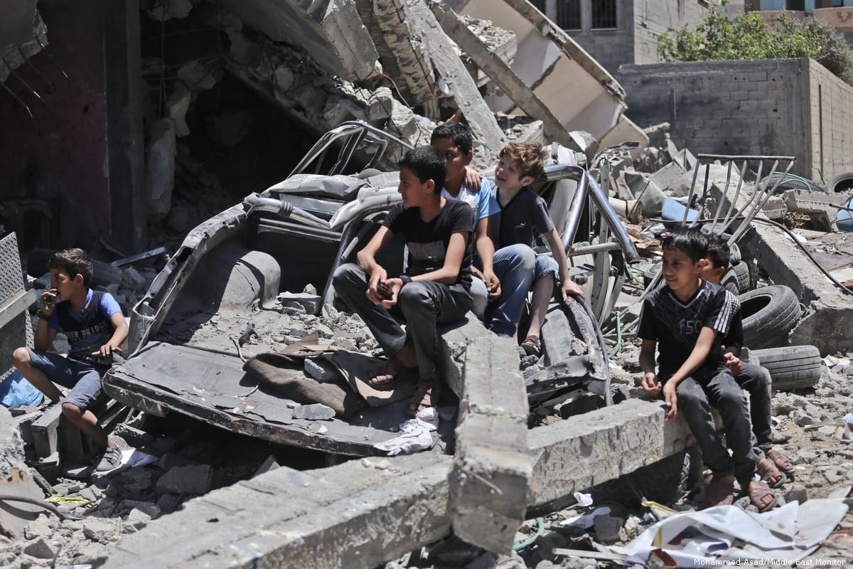 Palestinians perform on the ruins of a home which was bombed by Israeli warplanes in Gaza on 14 May 2019 [Mohammed Asad/Middle East Monitor]