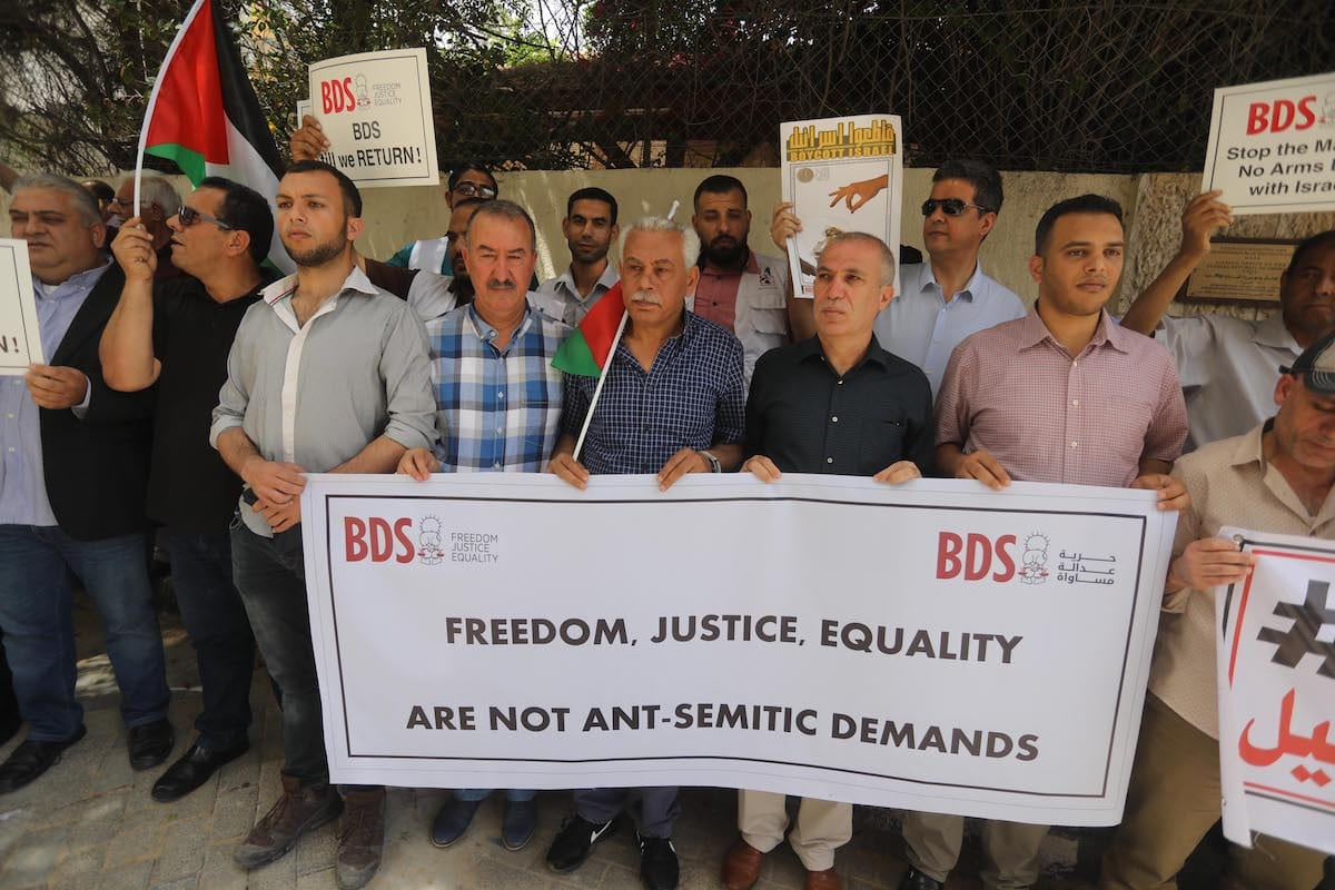 Palestinians in Gaza protest against German Parliament decision on BDS, in Gaza on 23 May 2019 [Mohammed Asad/Middle East Monitor]