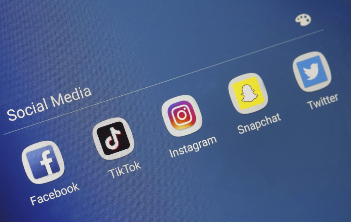Social medias applications logos, Facebook, Tik Tok Instagram, Snapchat and Twitter are displayed on the screen of a tablet on 7 November, 2018 in Paris [Chesnot/Getty Images]