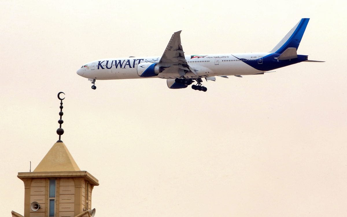 A Kuwait Airways Boeing B777 aircraft prepares to land at Kuwait International Airport in Kuwait City on 13 March 2019 [Yasser Al-Zayyat/AFP/ Getty]