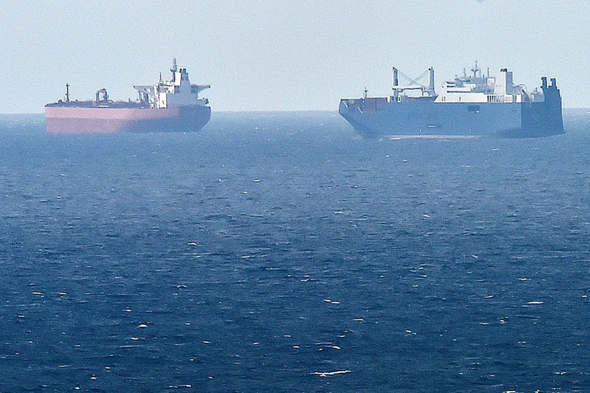 A picture taken on May 9, 2019 from northern port of Le Havre, shows Saudi cargo ship Bahri Yanbu (R) next to British crude oil tanker Nordic Space (L) waiting in the port of Le Havre. - French President defended his country's arms sales to Saudi Arabia and the United Arab Emirates on 9 May 2019 [JEAN-FRANCOIS MONIER /AFP/Getty]