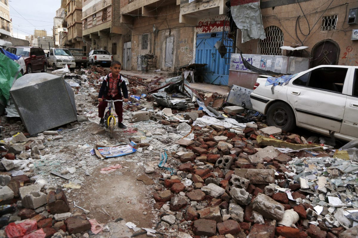 A Yemeni boy rides a bike on rubble of houses destroyed in a recent air strike carried out by the Saudi-led coalition, on 23 May 2019 in Sana'a, Yemen [Mohammed Hamoud/Getty Images]