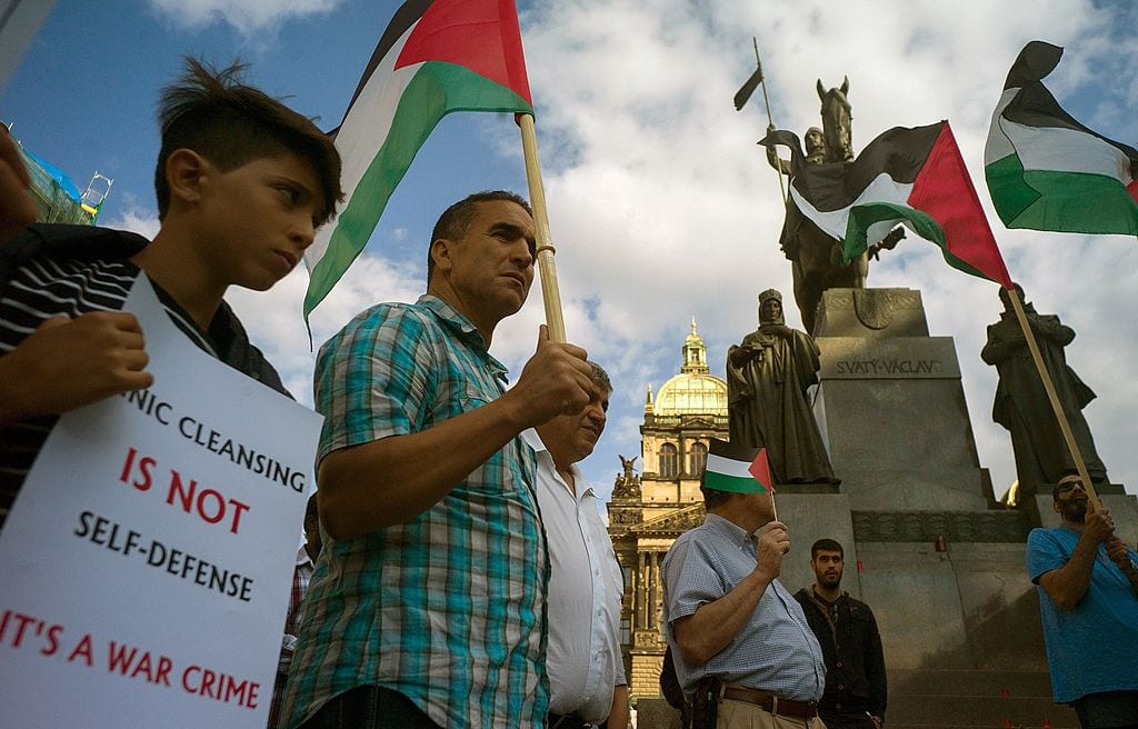 Pro-Palestinian protesters holding banners and Palestinian flags attend a rally in solidarity with Palestinians killed in Israeli assaults in Gaza on July 24, 2014 in Prague. [MICHAL CIZEK/AFP/Getty Images]