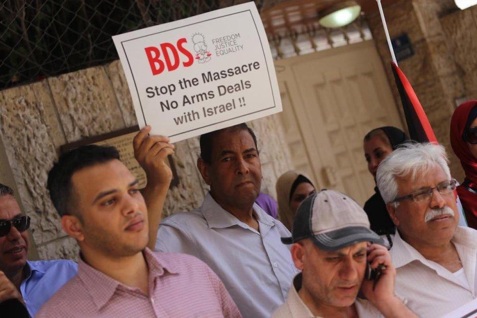 Des Palestiniens de Gaza protestent contre la décision du Parlement allemand sur le BDS, à Gaza le 23 mai 2019 (Mohammed Asad / Middle East Monitor)