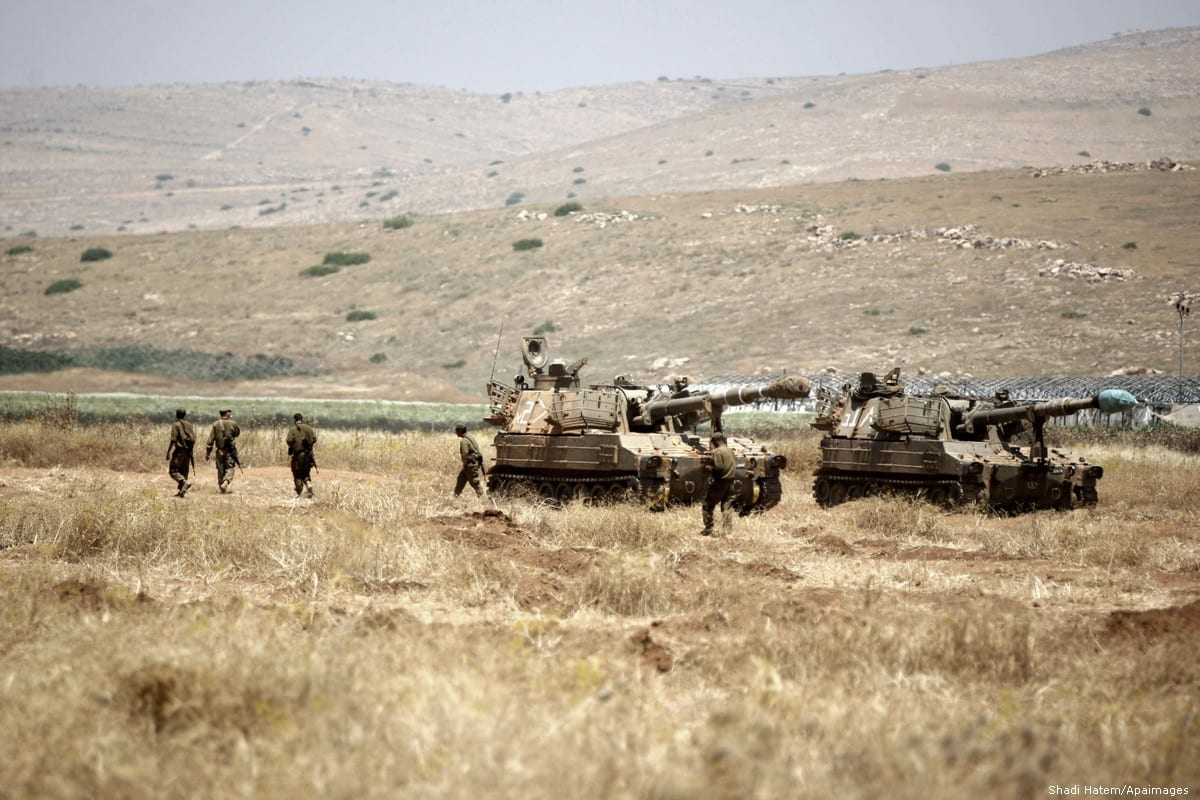 Israeli military tanks are seen stationed in the Jordan Valley during a military training exercise on 6 May 2015 [Shadi Hatem/Apaimages]