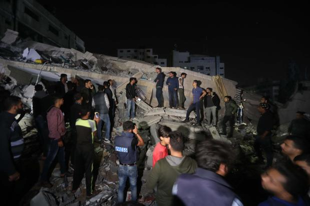 Israel struck 3 residential buildings in the besieged Gaza Strip on 4 May 2019 [Mohammed Asad/Middle East Monitor]