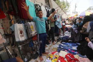 Palestinians can be seen in the marketplace preparing for Eid celebrations in Gaza on 3 June 2019