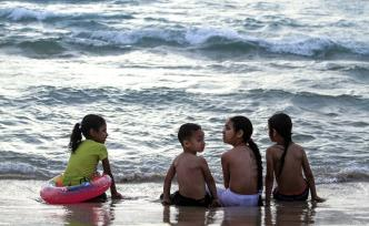 Palestinians swim in the Mediterranean sea on the coast of Gaza city, on the second day of Eid al-Fitr holiday which marks the end of the Muslim holy month of Ramadan, on 6 June, 2019 [Mahmoud Khattab/Apaimages]