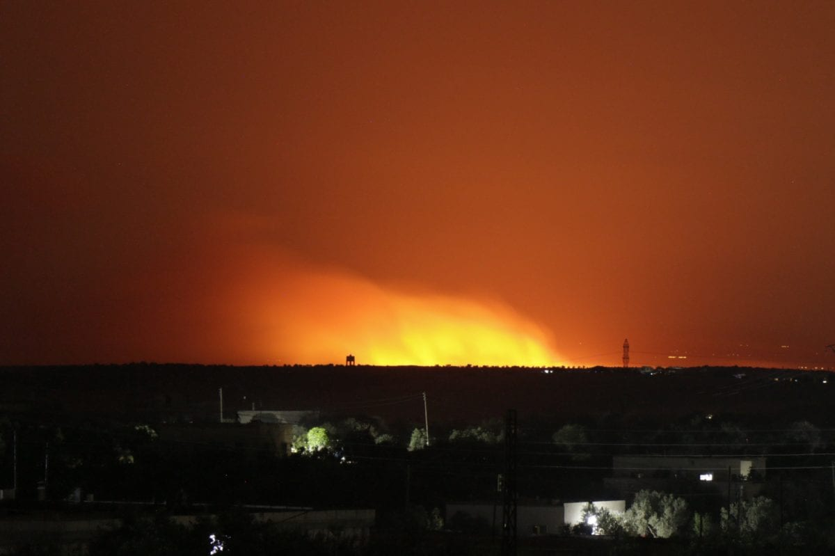 A blast illuminates the night sky after an alleged napalm bomb attack by Assad Regime and Russia in the de-escalation zone of Khan Shaykhun town of Syria's Idlib on 1 June 2019. [Muhammed Ali - Anadolu Agency]