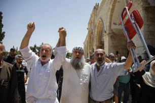 Muslims shout slogans as Jews, under Israeli police protection, raid Al-Aqsa Mosque Compound in Jerusalem on June 02, 2019. ( Faiz Abu Rmeleh - Anadolu Agency )