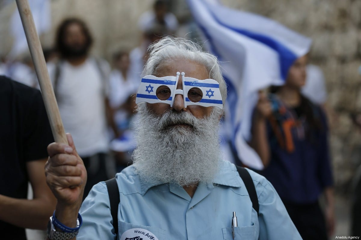 Israelis participate in a celebration march as part of the 52nd anniversary of the occupation of East Jerusalem by Israel, at Jerusalem's Old City on June 02, 2019 [Faiz Abu Rmeleh / Anadolu Agency]
