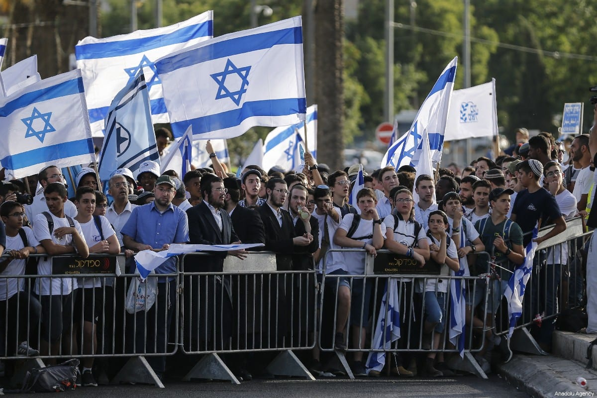 Jews participate in a celebration march as part of the 52nd anniversary of the occupation of East Jerusalem by Israel, at Jerusalem's Old City on 2 June 2019. [Faiz Abu Rmeleh - Anadolu Agency]