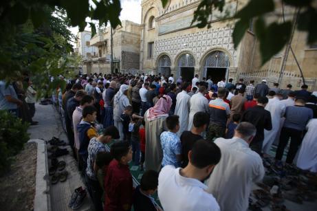 Muslims perform Eid al-Fitr prayer at Fatima Zahra Mosque in Al Bab district of Aleppo, Syria on June 4, 2019. [Ömer Alven/Anadolu Agency]