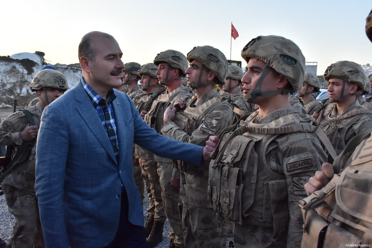 Turkish Interior Minister Suleyman Soylu greets soldiers after performing Eid al-Fitr prayer with soldiers at a military base in Sirnak's Tuzluca districts' Kato Mountain on June 4, 2019 [Hasan Namlı / Anadolu Agency]