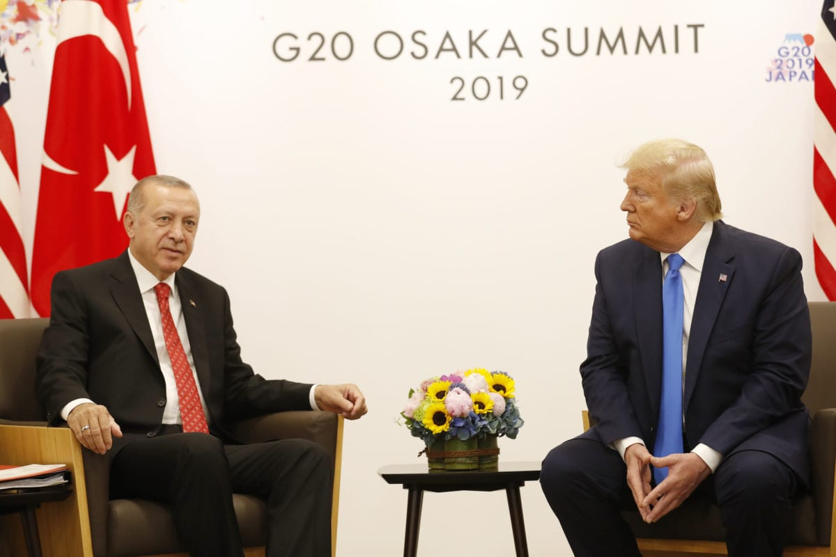 President of Turkey, Recep Tayyip Erdogan (L) meets with U.S President Donald Trump (R) on the sidelines of the second day of the G20 Summit at INTEX Osaka Exhibition Center in Osaka, Japan on 29 June 29 2019. [Turkish Presidency / Murat Cetinmuhurdar / Handout - Anadolu Agency]