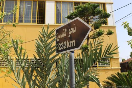 """232km towards Jerusalem"" sign in the courtyard of Galilee Secondary School."