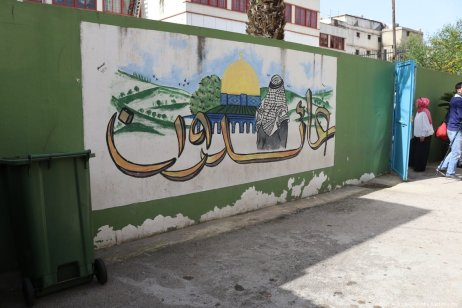 """Returning"" mural in the playground of Galilee Secondary School, expressing Palestinian refugees' yearning to return to their homeland."