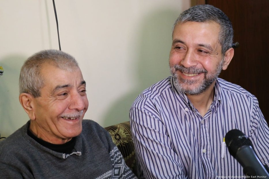 Abu Wehbe (left) and his brother, both residents of Nahr Al-Bared, pictured mid-laugh.