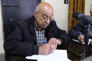 Isa Al-Sayid, a trustee of the popular committee.