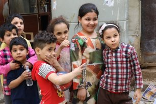 Children pose for the camera in Shatila camp.
