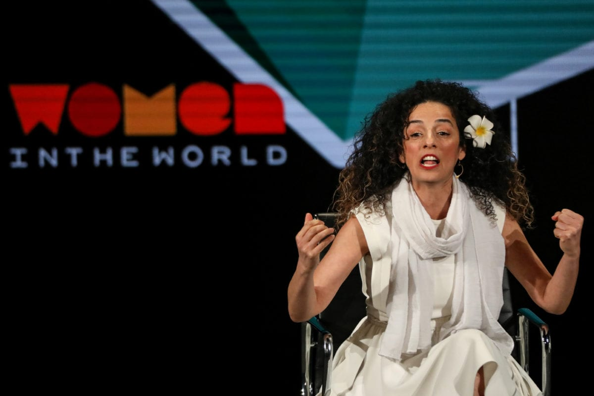 Masih Alinejad, Iranian journalist and women's rights activist, speaks on stage at the Women In The World Summit in New York, US, on 12 April 2019. [REUTERS/Brendan McDermid]