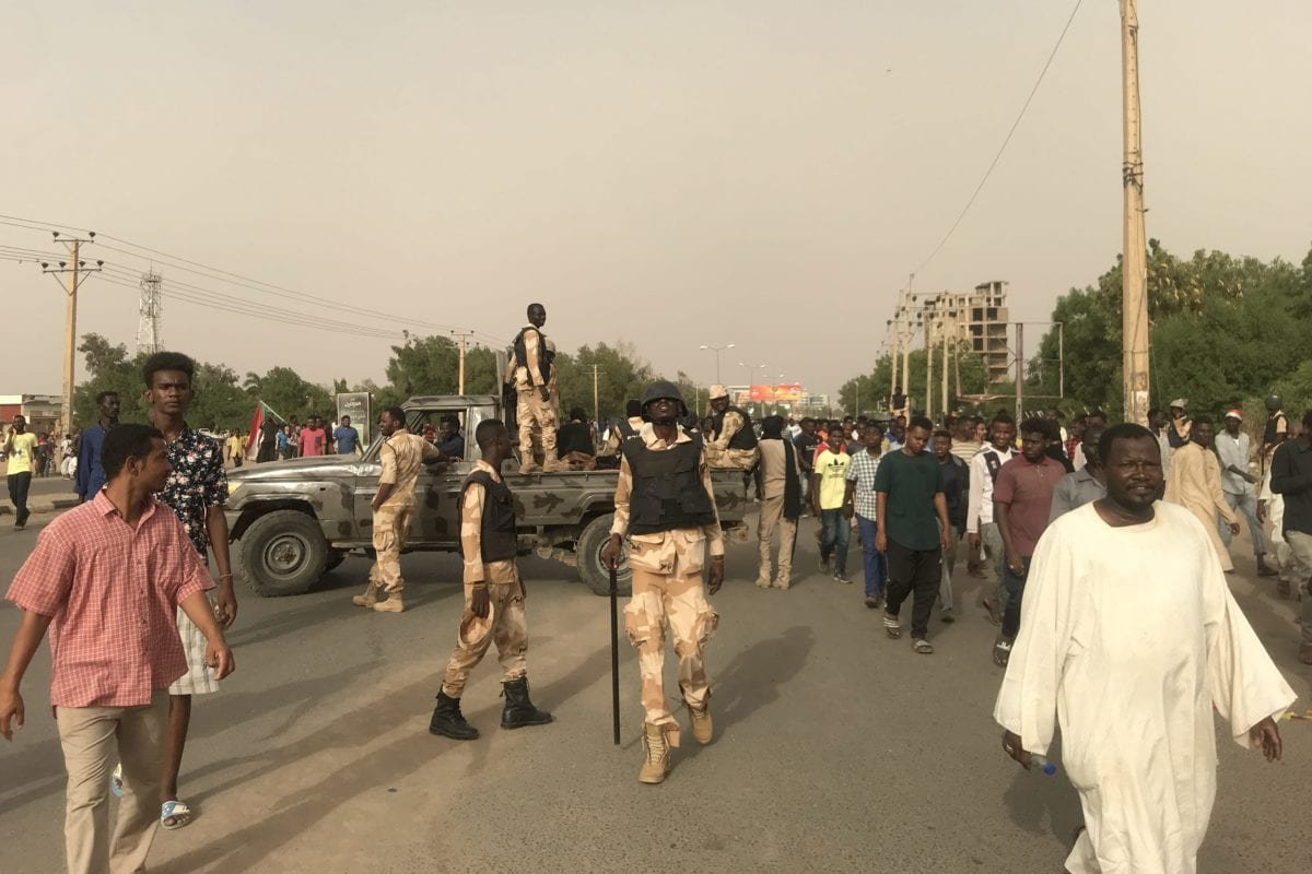 Security forces block the roads as thousands of Sudanese protesters stage a demonstration after the call from Sudanese Professionals Association (SPA) and Alliance of Freedom and Change, demanding the ruling military council to hand over power to civilian authorities, in Khartoum, Sudan on 30 June 2019. [Ömer Erdem - Anadolu Agency]