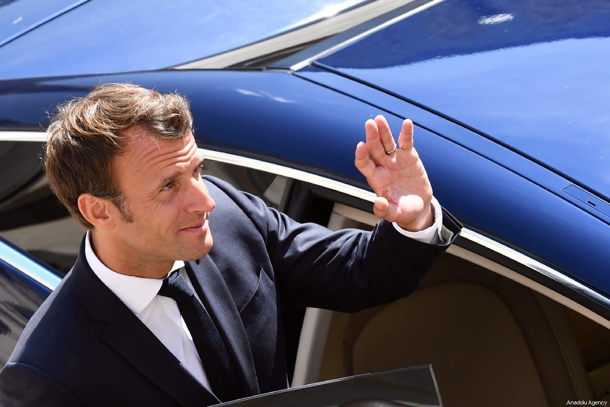 French President Emmanuel Macron waves as he leaves after a 'prise d'armes' military ceremony at the courtyard of the Invalides in Paris, France on 8 July 2019. [Mustafa Yalçın/Anadolu Agency]