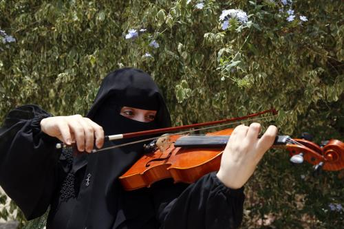 Yemeni youth take music classes and learn to play instruments such as violin, oud, piano and guitar to escape the memories of civil war in Sanaa Yemen on 25 July 2019 [Mohammed Hamoud/Anadolu Agency]