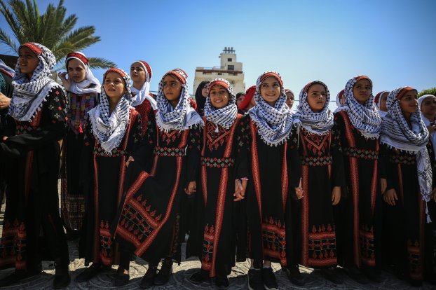 Palestinians wear traditional costumes to celebrate the Traditional Palestinian Dress Day in Gaza City, on 30 July, 2019 [Ali Jadallah/Anadolu Agency]