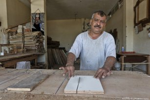 'I would prefer to keep earning a daily wage of $17 through carpentry instead of thousands coming through the deal of the century ,' Ahmad Abu Tair, a carpenter