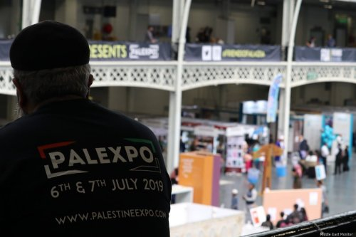 A volunteer at the Palestine Expo 2019 on 6 July 2019 in London, UK [Middle East Monitor]