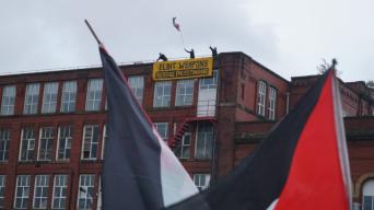 Activists from the Manchester Palestine Action network scale the roof of the Israeli owned Elbit/Ferranti arms manufacturer in Oldham in protest of UK complicity in Israel's human rights violations, on 1 July 2019 [Manchester Palestine Action]