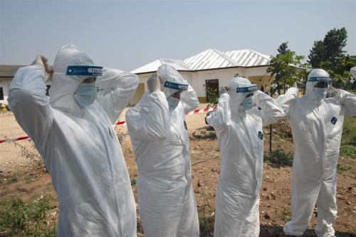 Personnel from Combined Joint Task Force-Horn of Africa (CJTF-HOA) and the Kamenge Military Hospital practice doffing hazardous material suits at the Kamenge Military Hospital, Bujumbura, Burundi, June 20, 2019. [U.S. Navy photo/Nick Scott]