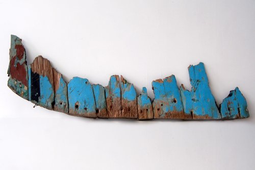 'Leave or Remain', burnt remains of a shipwrecked migrant boat [Maya Ramsay]